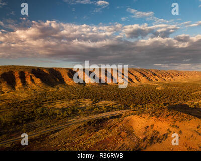 Aerial shot of the MacDonnell Ranges with the famous Namatijira Drive. - Stock Photo