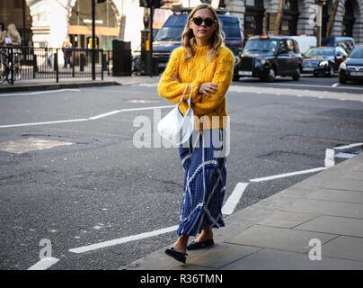 LONDON, UK- February 16 2018: Jessie Bush on the street during the London Fashion Week. - Stock Photo