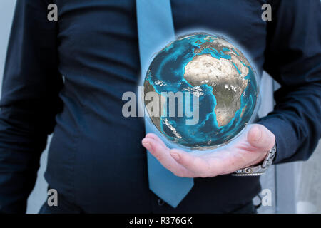 Businessman in black shirt and blue necktie holding globe in his hand - Stock Photo