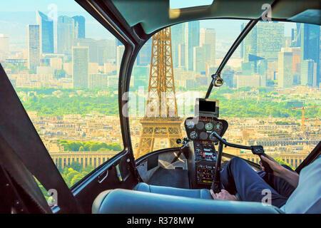 Helicopter cockpit flying on Paris Tour Eiffel tower skyline. Scenic flight over Paris skyline. - Stock Photo