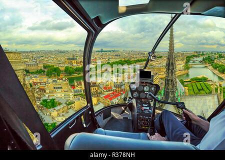 Helicopter cockpit flying on Pont Saint-Michel bridge on Senna river of Paris, French capital, Europe. Scenic flight above Paris skyline. - Stock Photo