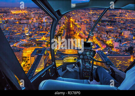Helicopter cockpit flying on Gare Montparnasse in Paris, French capital, Europe. Scenic flight above Paris urban cityscape. Parisian style architecture of France in Europe. Night scene. - Stock Photo