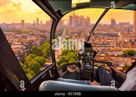 Helicopter cockpit flying on Charles de Gaulle square in Paris, French capital, Europe. Scenic flight above Paris skyline in France, Europe. Scenic urban cityscape and Parisian skyline on sunset. - Stock Photo