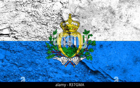 Flag of San marino close up painted on a cracked wall, concept of armed actions and conflicts in the world - Stock Photo