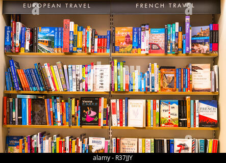 Travel guide book on sales on shelves of local Bookshop in Cambridge, England, UK - Stock Photo