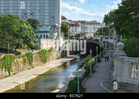 View of the canal embankment in the city park of the city of Vienna - Stadtpark, Austria, on a bright sunny day. - Stock Photo