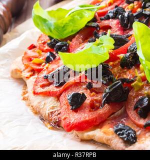 homemade olive - tomato pizza - Stock Photo