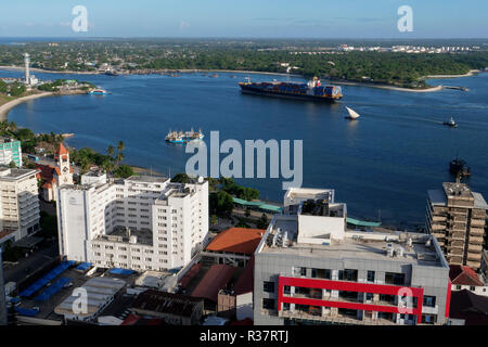 TANZANIA Daressalaam, bay and seaport, Pacific International Lines PIL container ship sailing to indian ocean, in front protestant Azania Front cathedral, built during german colonial time - Stock Photo