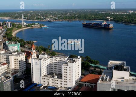 TANZANIA Daressalaam, bay and seaport, PIL container ship sailing to indian ocean, in front protestant Azania Front cathedral, built during german colonial time - Stock Photo
