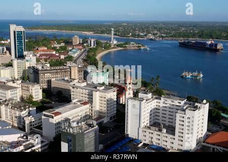 TANZANIA Daressalaam, bay and seaport, PIL container ship sailing to indian ocean, in front protestant Azania Front cathedral, built during german colonial time, Kigamboni Ferry Terminal - Stock Photo