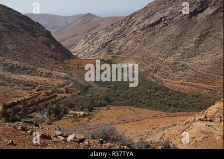 overlooking the reservoir and the mountains in betancuria - Stock Photo