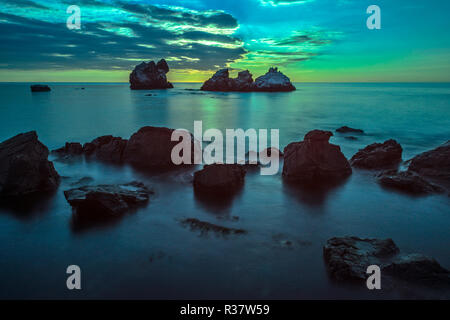 Beautiful seascape with rocks on the foreground in moonlight - Stock Photo