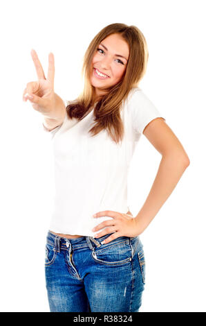 young girl showing victory sign isolated on a white background - Stock Photo