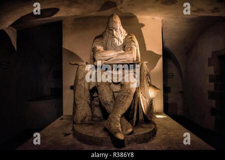 A statue of Holger the Dane by Hans Peder Pedersen-Dan in the casemates under Kronborg Castle. According to legend, Holger remains sleeping until he's - Stock Photo