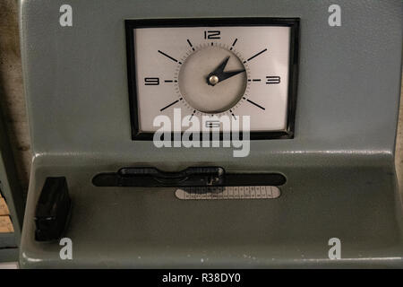 old stamp clock in front of an office - Stock Photo