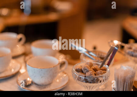 Group of empty cups in many rows of a white cup for coffee in breakfast and seminar event. designed in vintage retro style. - Stock Photo