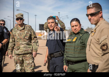 U.S. Calexico Port Director David Salazar, center, guides U.S. Army North Commander Lt. Gen. Jeffrey Buchanan, left, on a tour of the Calexico West Port of Entry in preparation for the migrant caravan November 13, 2018 in Calexico, California. They are accompanied by Chief Patrol Agent of the U.S. Border Patrol El Centro Sector Gloria Chavez and San Diego Director of Field Operations Pete Flores. - Stock Photo