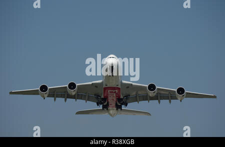 Dusseldorf, Germany - July 16, 2015: Airbus A380-800 of Emirates Airlines taking off at the airport of Dusseldorf with destination Dubai - Stock Photo