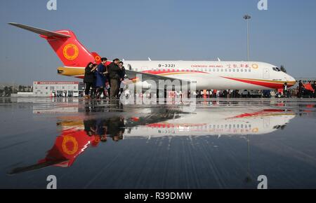 Beijing, China, 22 November 2018. The ARJ21, China's first commericial regional aircraft, is parked at the Shuangliu International Airport in Chengdu, capital of southwest China's Sichuan Province, Nov. 29, 2015. Subsidiaries of Aviation Industry Corporation of China (AVIC) and Commercial Aircraft Corporation of China Ltd. (COMAC) have set up a joint design center to develop noses for China-developed commercial aircraft, AVIC said Nov. 21, 2018. According to the cooperation agreement, AVIC Chengdu Aircraft Corporation Commercial Aircraft Co., Ltd and COMAC Shanghai Aircraft Desig Credit: Xinhu - Stock Photo