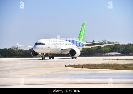 Beijing, China, 22 November 2018. The No.102 C919 plane taxis at Nanchang Yaohu Airport, east China's Jiangxi Province, Oct. 27, 2018. Subsidiaries of Aviation Industry Corporation of China (AVIC) and Commercial Aircraft Corporation of China Ltd. (COMAC) have set up a joint design center to develop noses for China-developed commercial aircraft, AVIC said Nov. 21, 2018. According to the cooperation agreement, AVIC Chengdu Aircraft Corporation Commercial Aircraft Co., Ltd and COMAC Shanghai Aircraft Design and Research Institute will join hands in designing noses for all aircraft m Credit: Xinhu - Stock Photo