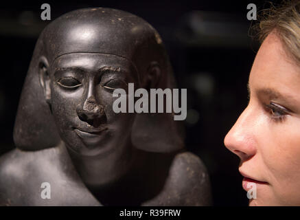 Bonhams, New Bond Street, London, UK. 22 November, 2018. Bonhams Antiquities sale features a magnificent selection of works depicting both exotic and domestic animals from the ancient world. Image: An Egyptian basalt bust of an official, late Period, late 26th Dynasty-30th Dynasty, circa 550-334 B.C. Estimate £40,000-60,000. Credit: Malcolm Park/Alamy Live News. - Stock Photo