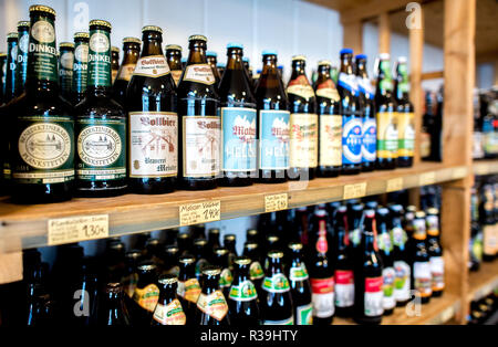 Hannover, Germany. 21st Nov, 2018. The bottles of various beer brands are on a shelf in a beverage market in the Linden district. Credit: Hauke-Christian Dittrich/dpa/Alamy Live News - Stock Photo