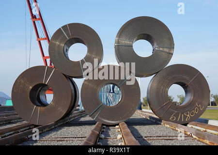 Stack of rolls of iron sheet in the ironmaster, steel manufacturing industry - Stock Photo