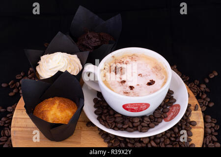 Delicious coffee and chocolate muffins - Stock Photo