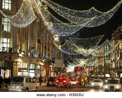 View looking up at the festive Christmas lights at night  in Regent Street London 2018 - Stock Photo