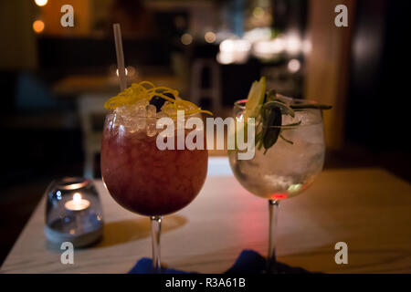 Two craft cocktail drink in a upscale cocktail lounge - Stock Photo