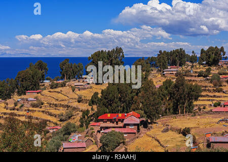View of a traditional village on a island at titicaca lake, Puno Peru - Stock Photo