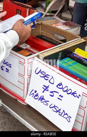 Miami Miami Florida-Dade College Book Fair annual event booths stalls vendors booksellers books sale shopping used $5 Spanish English language bilingu - Stock Photo