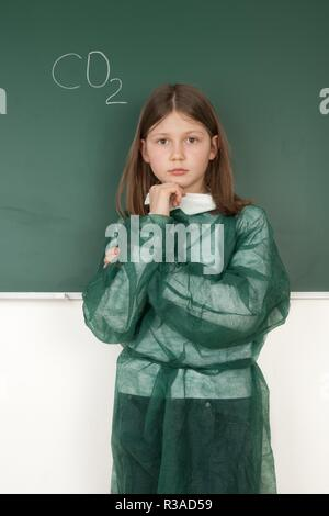 girl at blackboard while thinking - Stock Photo