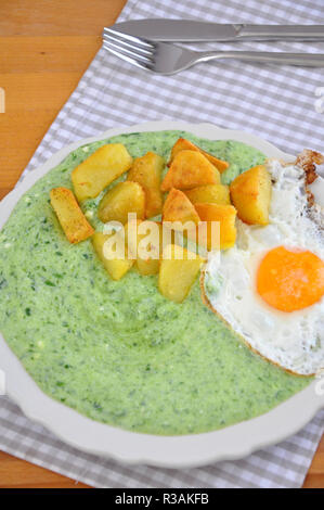 grated spinach with boiled potatoes - Stock Photo