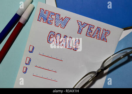 Top view NEW YEAR GOALS text list with marker and eyeglasses for business presentation mock up for adding your list - Stock Photo