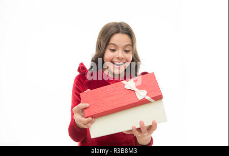 Feeling so excited. Kid little girl in elegant dress hold gift box white background. Child excited about unpacking her gift. Small cute girl received holiday gift. Best toys and christmas gifts. - Stock Photo