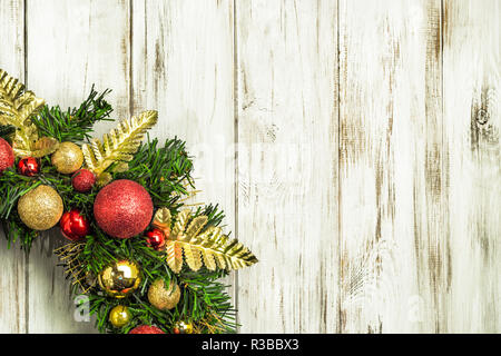Green Christmas wreath on wooden door decoration - Stock Photo