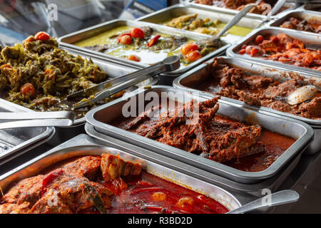 Indonesian food buffet dishes consist of meat, chicken, seafood and vegetables at Javanese restaurant in Bali. - Stock Photo