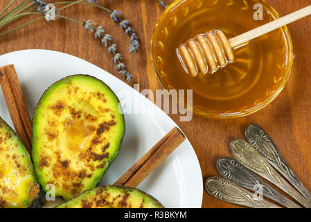 Avocado with cinnamon and honey ready to be served - Stock Photo
