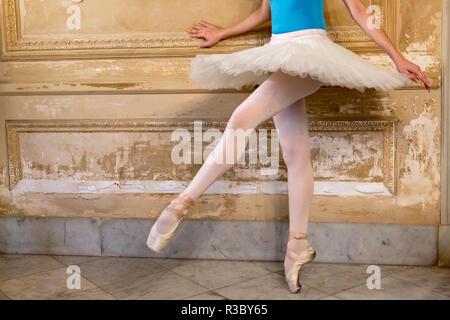 Cuba, Havana. Ballerina balancing on one leg. Credit as: Wendy Kaveney / Jaynes Gallery / DanitaDelimont.com - Stock Photo