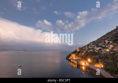 Shipyard (Tersane) and the ruins of a medieval fortress (Alanya Castle) on the mountainside. Photographed from Kizil Kule (Red Tower) - main tourist a - Stock Photo