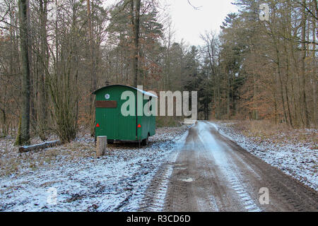 Trailer for lumberjacks stands in the forest. - Stock Photo