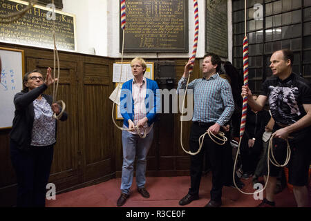 Church bell-ringers ahead of Remembrance Day practice their bell-ringing at St Mary's Church, Rotherhithe, Southeast London, United Kingdom - Stock Photo