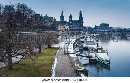 Panoramic image of Dresden, Germany during et the winter evening with Elbe River in the foreground. - Stock Photo