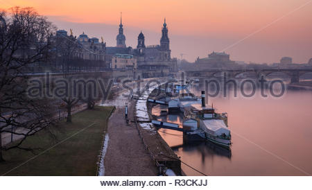 Panoramic image of Dresden, Germany during sunset with Elbe River in the foreground. - Stock Photo
