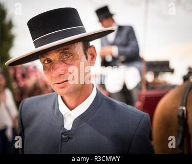 Portrait of man in traditional dress, Feira de Cordoba, Cordoba, Andalucia, Spain - Stock Photo