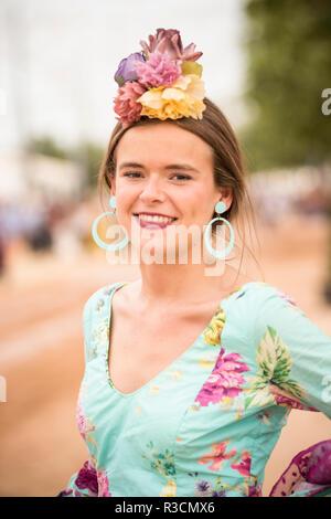 Portrait of girl in traditional dress, Feira de Cordoba, Cordoba, Andalucia, Spain - Stock Photo
