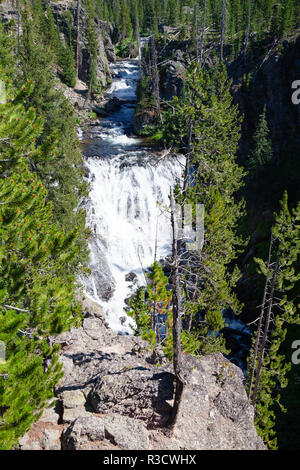 Kepler Cascades is a waterfall on the Firehole River in southwestern Yellowstone National Park, USA. The cascades are located approximately 2.6 miles  - Stock Photo