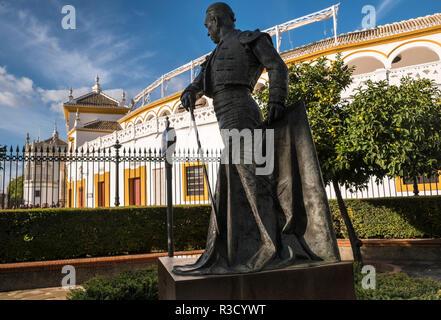 Bronze sculpture of Francisco Romero López, known as Curro Romero, outside Plaza de Toros de la Real Maestranza bullring, Seville, Andalucia, Spain. - Stock Photo