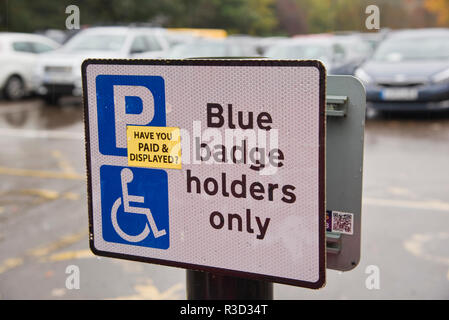 Sign reminding disabled drivers to pay for car parking. - Stock Photo
